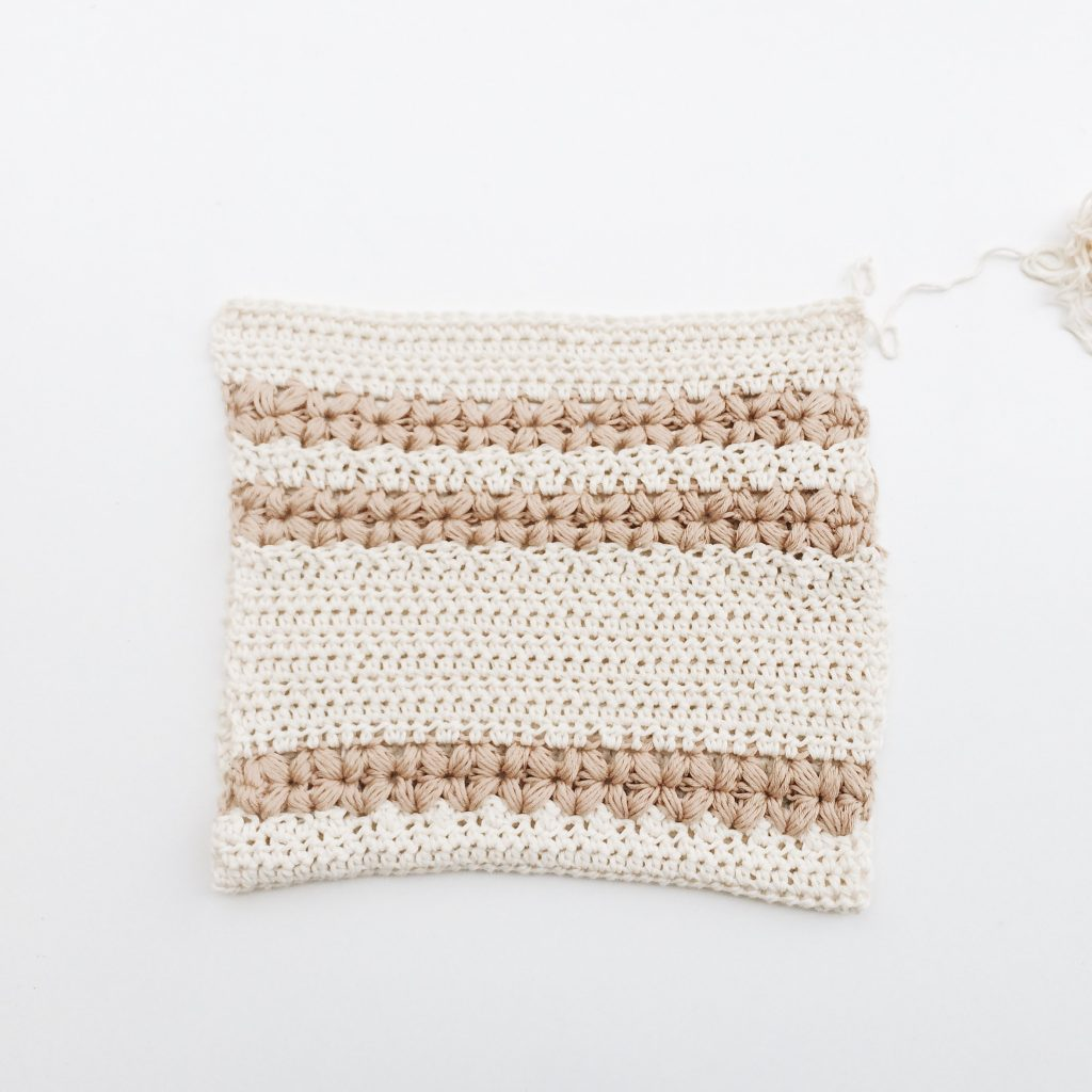 white and brown knit textile