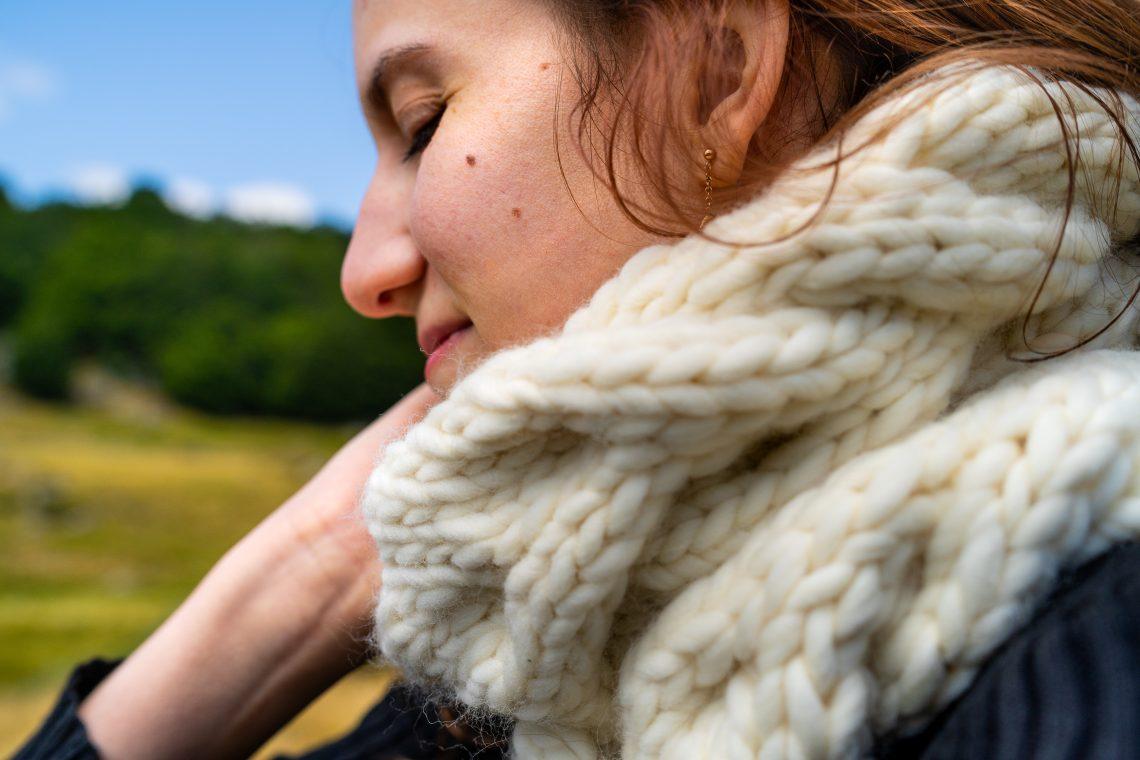 woman wearing white scarf smiling