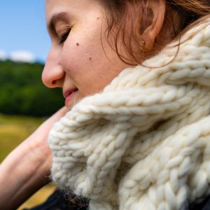 woman wearing white scarf smiling